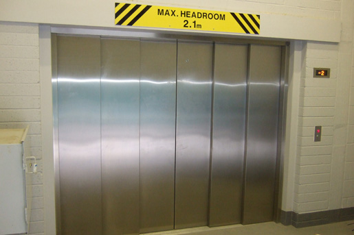Six-Panel Peelle Door on Hydraulic Vehicle Lift - Focus Lifts