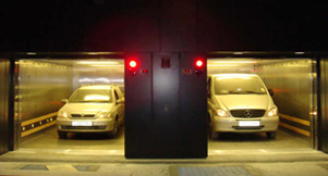 Heavy Duty Duplex Vehicle Lift with Peelle Doors - Focus Lifts